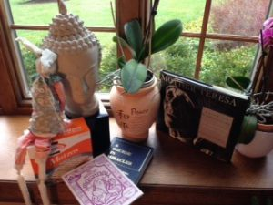 A bunny on matzo, Buddha, A Course in Miracles, The Santa Cruz Haggadah and Mother Teresa.
